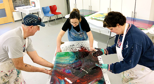 Artist Adele Webster of Glocca Morra teaches a private liquid glass pouring class in the Activity Room.