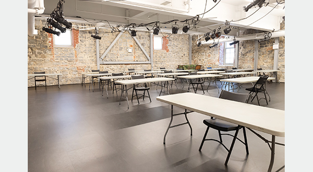 An example of furniture set up for a meeting with physical distancing measures in place