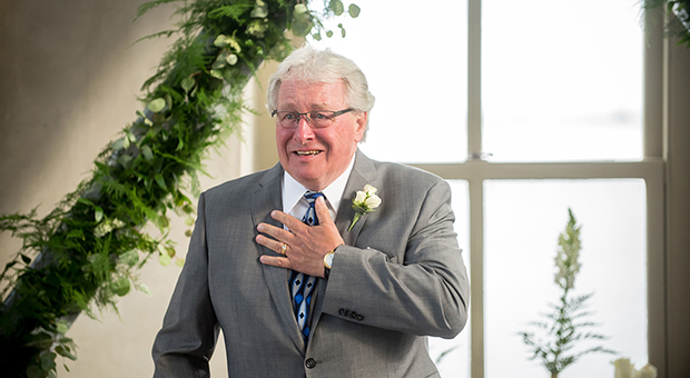 The surprised groom at his 50th wedding anniversary party and vow renewal ceremony at the Tett Centre