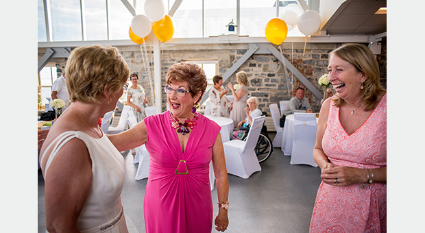 Guests greeting the bride after her vow renewal ceremony at the Tett Centre