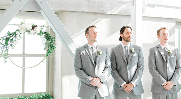 The groom and his groomsmen waiting before a wedding ceremony in the Malting Tower at the Tett Centre